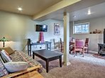 The cozy unit offers comfortable furnishings, rustic decor and a gas fireplace to warm up the whole space.