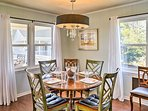 Home-cooked meals await to be served at this indoor 6-person dining table.