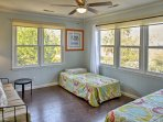 In the sunroom, you'll find 2 twin beds for additional sleeping arrangements.