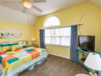 King size bed with TV, ocean view window and private bath