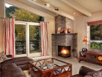 Spacious and comfortable Living Room with great Aspen Mountain views, Fireplace and Balcony