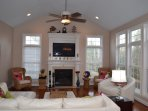 Living Room w/ Fireplace and Flat Screen TV