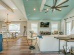 Open Floor Plan w/ Amazing Hardwood Flooring, updated furniture, and beautiful decor