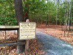 Entrance to nature preserve with trail to scenic lookout points is adjacent to building and parking.
