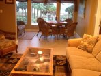 Living room and lanai with view to the beach