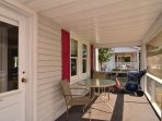 Large screened-in porch with ample seating and Beach Equipment Available for our Guests.