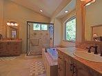 En suite master bathroom, added bonus of a jetted tub and separate sinks