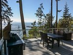The large deck  with new patio furniture and grill make for a great spot to enjoy your vacation.