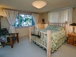 Moving to the bedrooms, the master bedroom has a queen size bed and daybed by the window. You can step out the door to...
