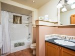 The downstairs bathroom is complete with tub shower combo.