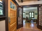 There is beautiful dark wood trim on the doorways and windows of this island home.