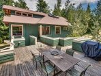 The deck is elevated and offers a sunny, protected spot for morning or evening meals.