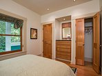 The closets in the guest bedroom offer plenty of storage space for suitcases and other items.