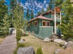 Coho Lane House is at the end of a private drive. A spacious deck is at the left and can be accessed from house or...