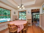 The dining area has access to the outdoor deck &  BBQ.