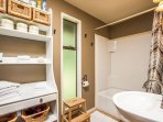 This newly updated bathroom is tastefully styled and offers a large tub & shower combination.