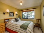 A cozy guest bedroom welcomes you to a hard-earned rest after another wonderful island day.