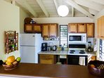 Prepare meals at home in the fully equipped kitchen.