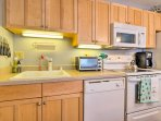 The kitchen offers a dishwasher, 4-burner electric stovetop, oven, microwave, coffee maker, and more!