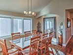 Gather around the 8-person dining table to enjoy a home-cooked meal with the family.