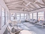 The whole group can gather in this spacious sunroom to hang out while enjoying lake views.