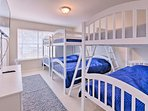 Kids will love sleeping in this bedroom with 3 bunk beds.