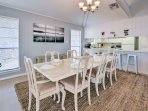 Serve meals at this spacious dining table.