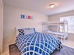 This bedroom offers a queen bed and twin-over-twin bunk bed.
