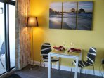 Stylish dining area and beautiful art for relaxing beach atmosphere