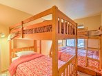 The second bedroom features 1 twin-over-full bunk bed and 1 twin-over-twin bunk bed.