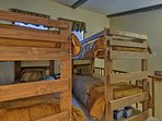 Up in the loft, 4 guests can sleep in the twin-over-twin bunk beds.