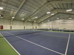 The indoor tennis facility has new courts and a basketball hoop!