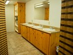 Large bathroom- includes 3 showers, 2 toilets, 2 urinals and 4 sinks