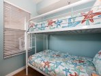 Cozy bunk room also features new comforters on the bunk beds