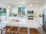 Fully equipped kitchen with a stunning view of the ocean