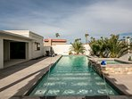 Outdoor living, with custom pool, spa, baja shelf, and deck jets