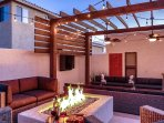 Outdoor living with custom  fire pit, TV and soundbar