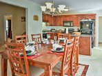 Gather around this dining table to enjoy meals with the group.
