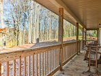 The expansive porch offers a great spot to kick back, relax and reconnect with nature.