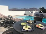 Bay View Villa - Outside Dinning Table with Stunning Views of the Pool and Femes Mountains