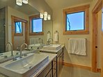 A his-and-hers vanity in the master bathroom ensures you have plenty of space.