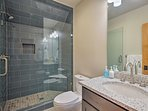 Clean up in the second bathroom, equipped with a walk-in shower and granite single vanity.