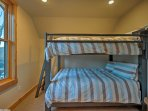 Choose a spot to sleep on the queen-over-queen bunk bed in the third bedroom.