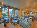 The floor-to-ceiling windows and open-floor-plan create a spacious and inviting atmosphere.