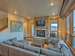 Warm up by the gas fireplace while you watch a movie on the flat-screen cable TV.