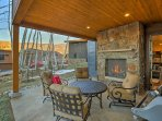 Fire up the stainless steel gas grill for a night of burgers by the outdoor gas fireplace.