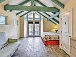 The master bedroom has its own balcony and gorgeous vaulted ceilings.