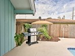 Grill your favorite meals on the gas grill in the private yard.