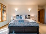The king-size bed in the Master Bedroom is topped with elaborate, fluffed comforters.