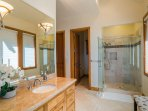 The master bathroom is elegantly designed with a stand-alone shower tucked in the corner.